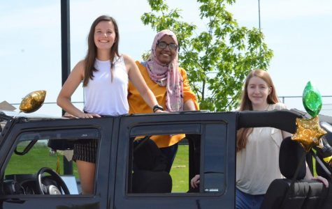 Seniors Kaitlyn Hansen, Khlood Saeed and Elena Koogler pose for a photo during the senior car parade on May 31.