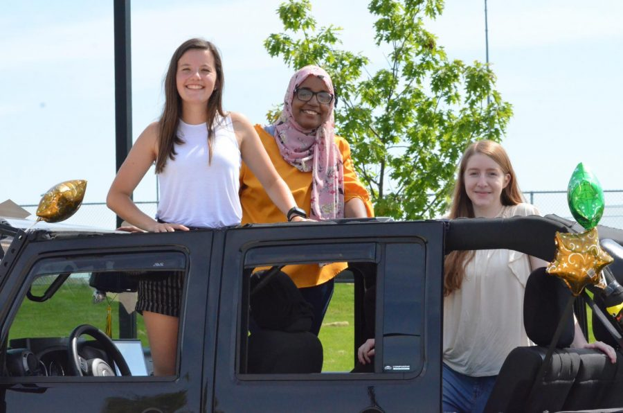 Seniors+Kaitlyn+Hansen%2C+Khlood+Saeed+and+Elena+Koogler+pose+for+a+photo+during+the+senior+car+parade+on+May+31.
