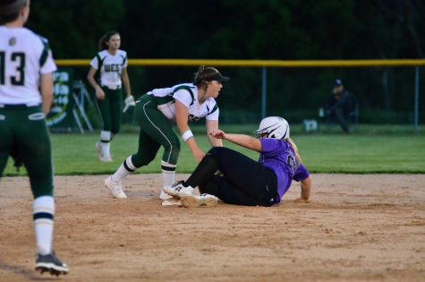 Freshman Lexi Nash tries for a double play after an out at first base by Liv Williams '21.