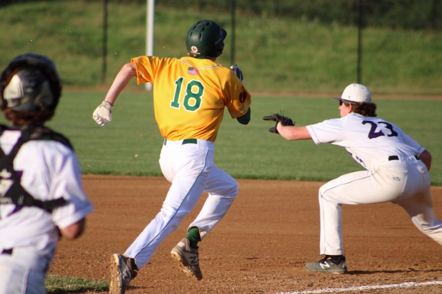 Ben Vander Leest '20 makes it to second base after hitting the ball.