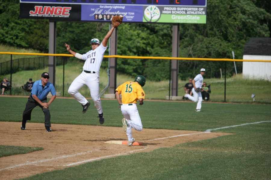 Mason Dains '20 safely makes it to first base in the first game of the doubleheader.