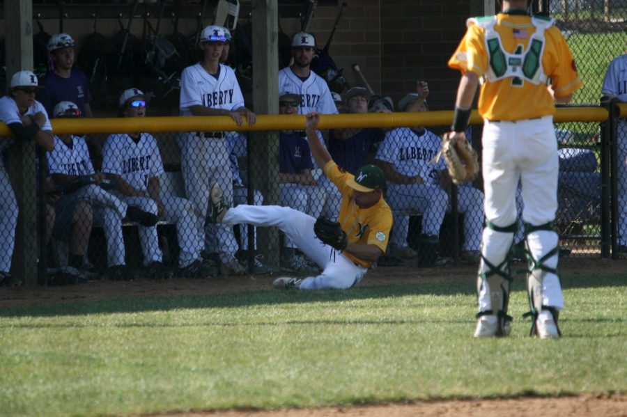 Will Hoeft '20 slides after the ball in the first game of the double header on June 23.
