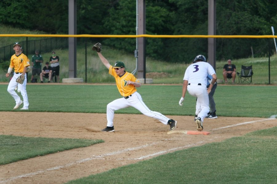Brett Cherry '20 forces out a Liberty player on first.