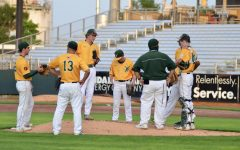The Trojans' infield regroups during a mound visit at Veterans Memorial Stadium on July 17.