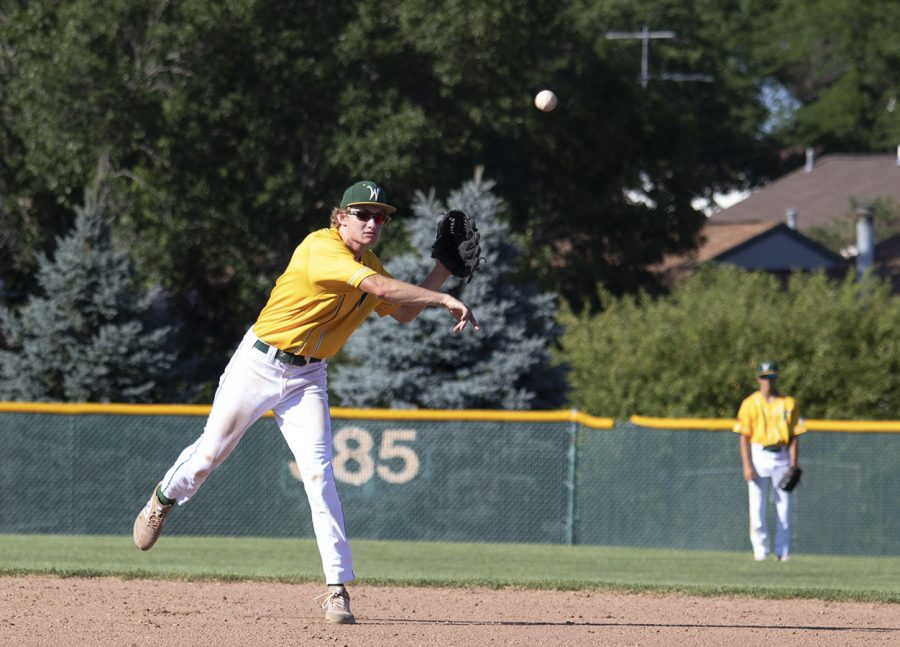 Ben Vander Leest '20 throws a ball to first base July 10.