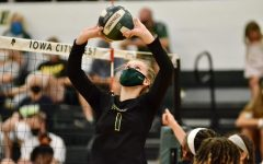 Emma Stammeyer '24 sets the ball against Kennedy on Aug. 25.