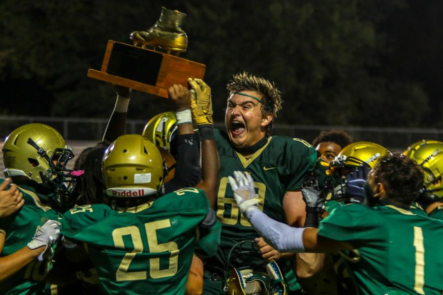 Liam Becher '22 and his teammates celebrate after the Battle for the Boot on Sept. 4.