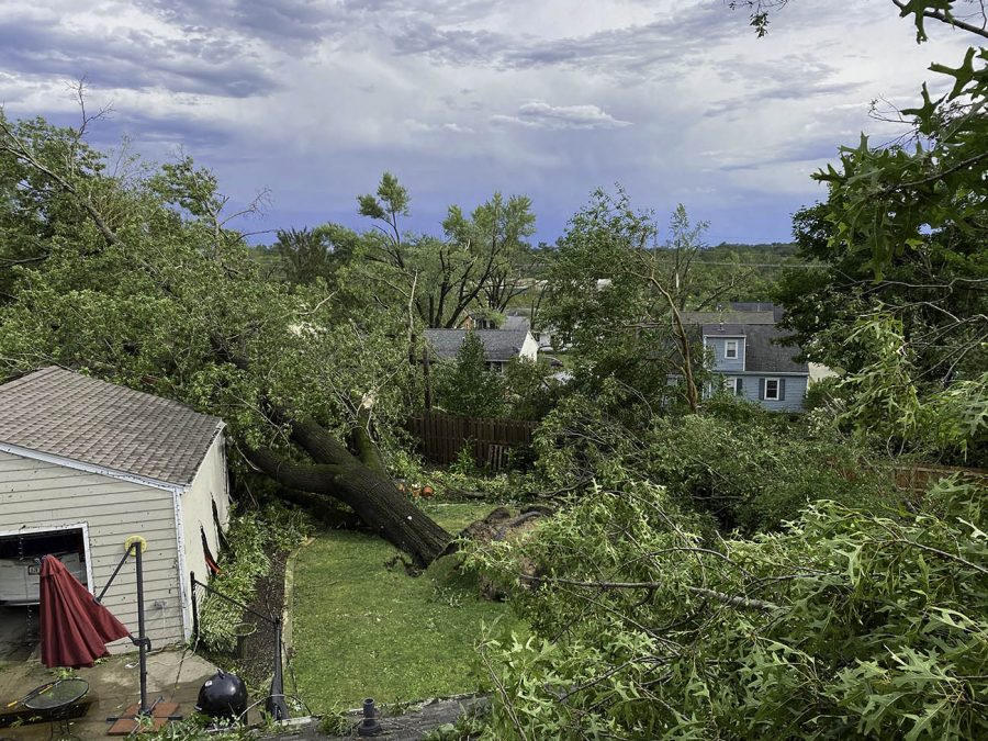 """I watched into our backyard as our 150 year old oak tree collapsed from the wind and destroyed our garage. It just didn't let up,"""" explained Welch. (Courtesy of Jon Welch)"""