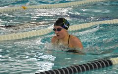 Lauren Trent '22 swims breaststroke during the 200 IM Sept. 29 against Dubuque Wahlert. Trent finished with a time of 2:21.88.