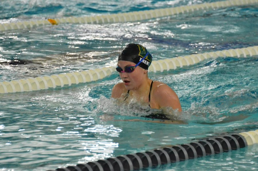 Lauren Trent 22 swims breaststroke during the 200 IM Sept. 29 against Dubuque Wahlert. Trent finished with a time of 2:21.88.