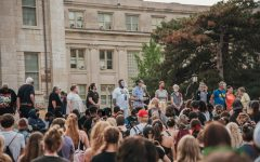 The Iowa City City Council speaks at an IFR protest at the Pentacrest.