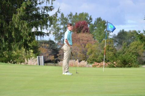 Caleb Kirk 21 waits with his ball marker in place as he finishes up on the 9th hole at Pleasant Valley.