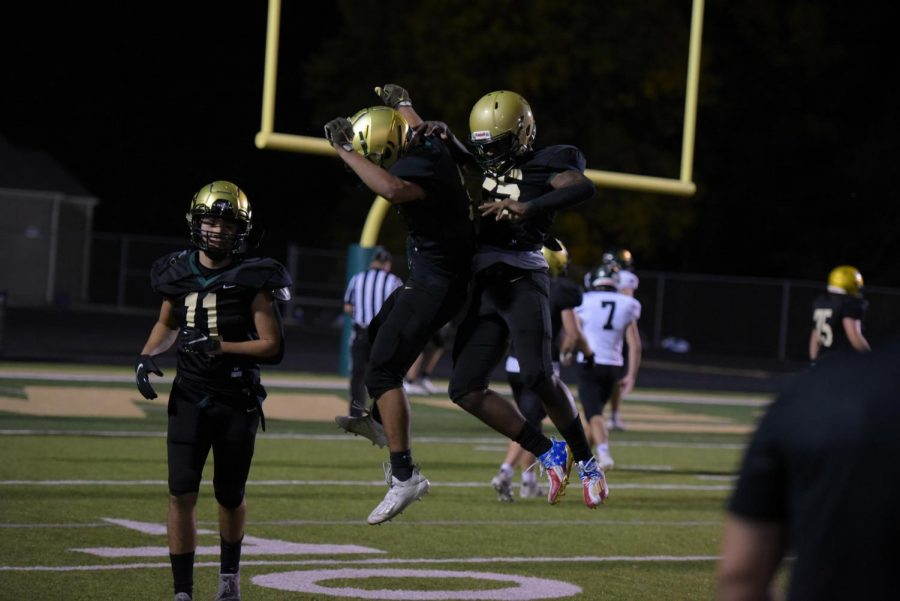 Fabian Brown '21 and Trey King '21 celebrate Brown's second touchdown of the night at West on Oct. 10.