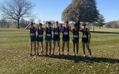 The boys cross country team poses for a picture before racing in the state meet in Fort Dodge on Oct. 30.
