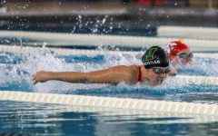 Junior Ella Hochstetler swims in the 100 butterfly at the Mercer Park Aquatic Center Oct. 17.