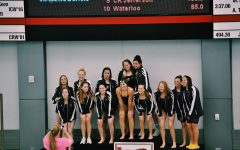 Greta Kraske '23 and the Iowa City West girls' swim team after they placed first during a conference meet at Linn-Mar on October 26, 2019.