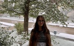 Rosemary Timmer-Hackert '23 stands out in the snow on October 19.