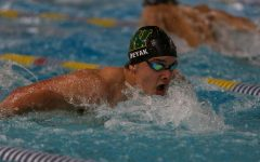 Nathan Deyak '21 swims in the 100 Butterfly against Waterloo on Dec. 15 at the Coralville Rec Center.