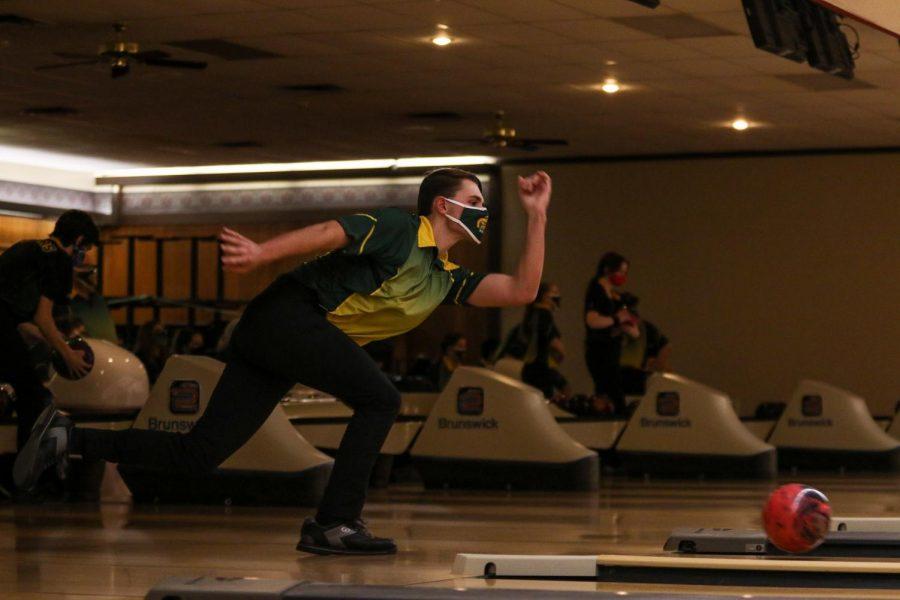 Ryan Bys '22 bowls a strike against Kennedy on Dec. 18.