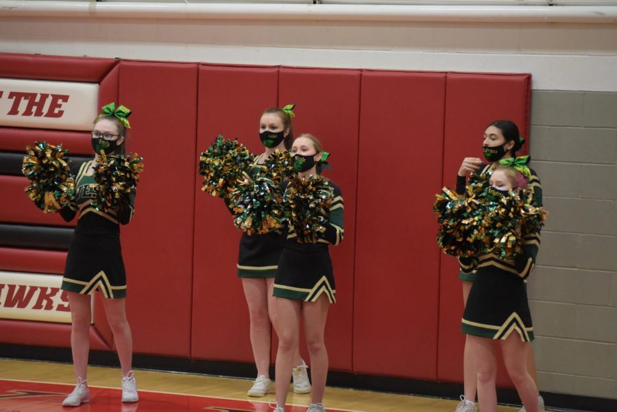 Cheerleaders take the sidelines at the City vs. West game Jan. 22.