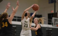 Audrey Koch '21 swings the ball around Southeast Polk defense for two points Jan. 2.