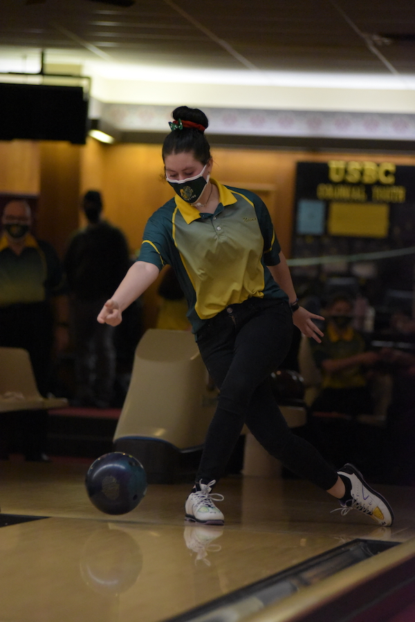 Neena Turnblom '23 watches the ball as she finishes her throw during the Battle for the Pins Jan. 7.