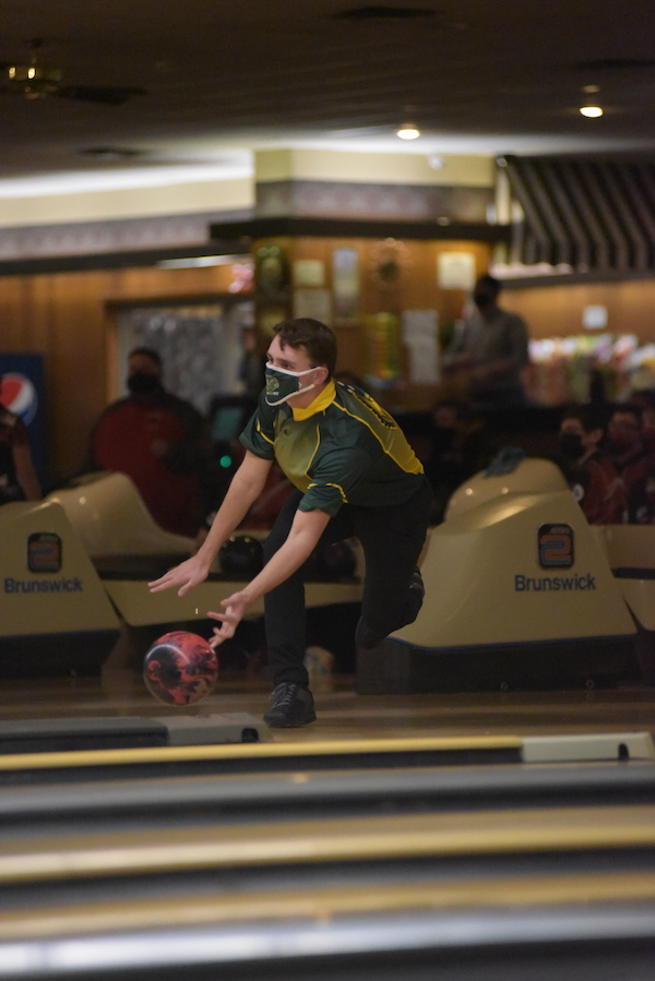 Ryan Bys '22 uses his whole body during his bowl Jan. 7. Bys bowled a 319 in two games.
