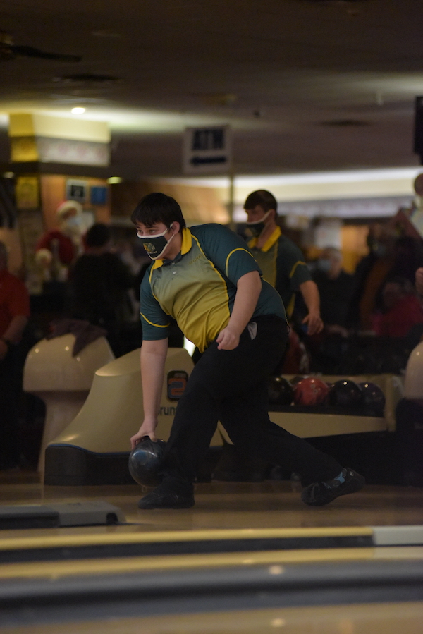 Max Whitehead '22 bowls on the junior varsity team in the next lane over Jan. 7.