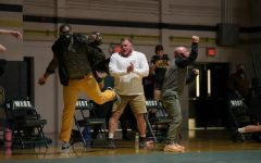 After a hard fought battle by Junior Brett Pelfrey in overtime, coaches cheer with excitement for the victory against Hempstead on Jan. 21.