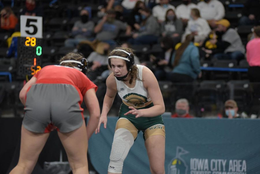 Emma Barker '22 stares down her opponent during the girls state wrestling tournament Jan. 22.