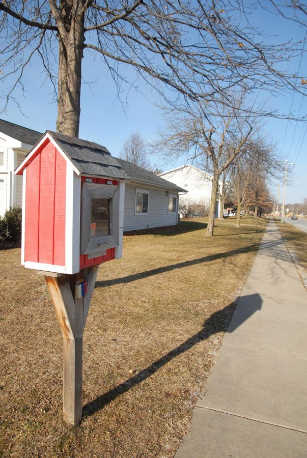 Frederick Newell, founder of Dream City, runs this Little Free Library to encourage young people to read.