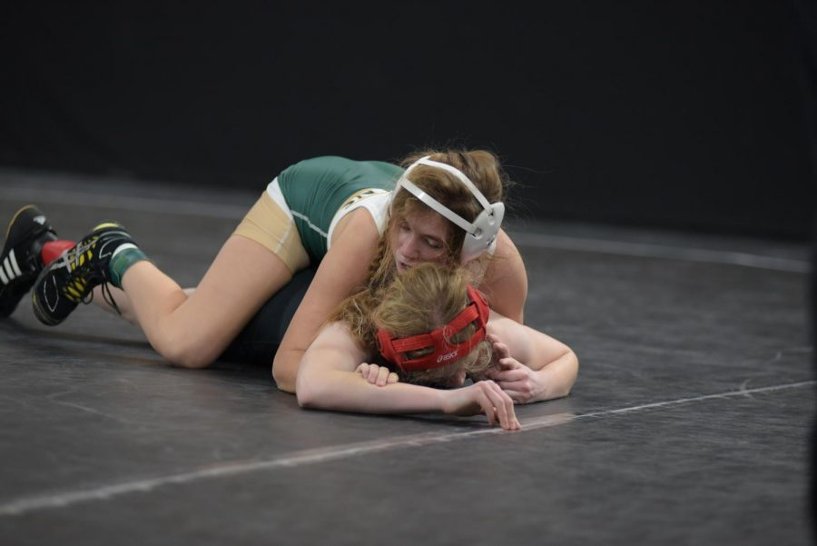 Marlie McBride '24 circles her opponent for points Jan. 22.