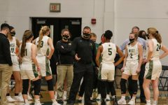 BJ Mayer addresses his team during a timeout versus Dubuque Hempstead on Jan. 12.