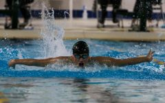 Andy Luo '22 swims in the 100 butterfly during a dual meet against Cedar Rapids Washington on Jan. 14.