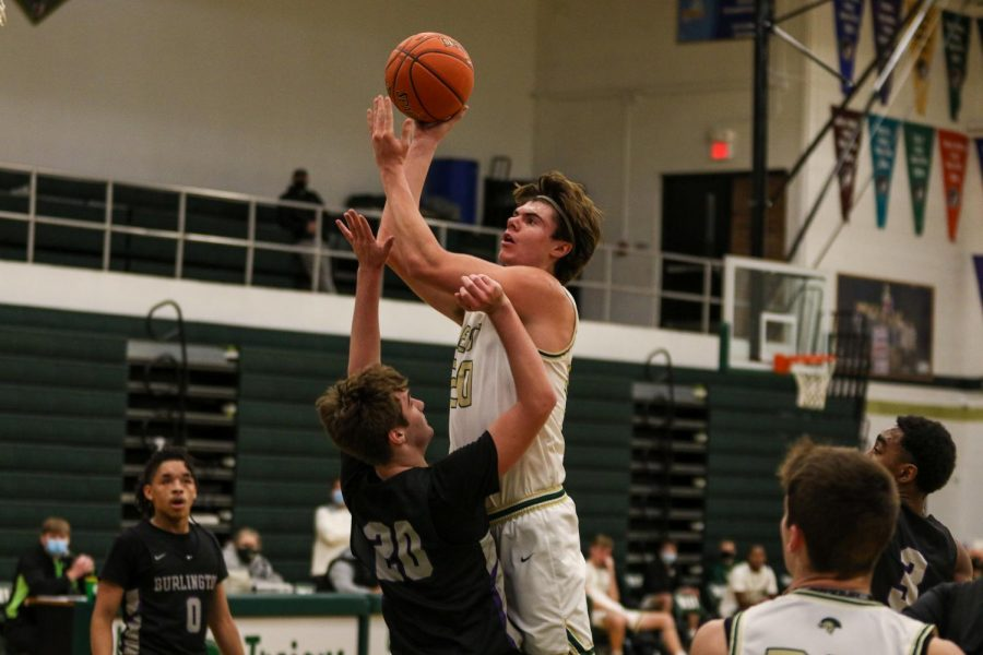Pete Moe '22 goes up for a layup over his defender against Burlington on Jan. 2.