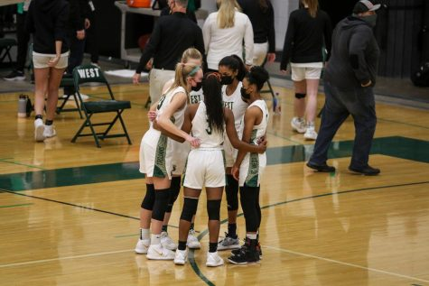 Starters huddle before tip-off against Fort Madison on Feb. 6.
