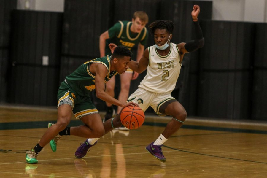 Christian Barnes '22 stays in front while playing defense against Kennedy on Feb. 11.