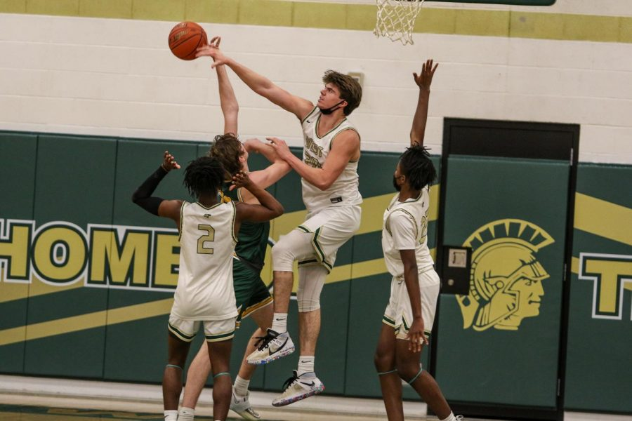 Pete Moe '22 swats a Kennedy layup against the Cougars on Feb. 11.