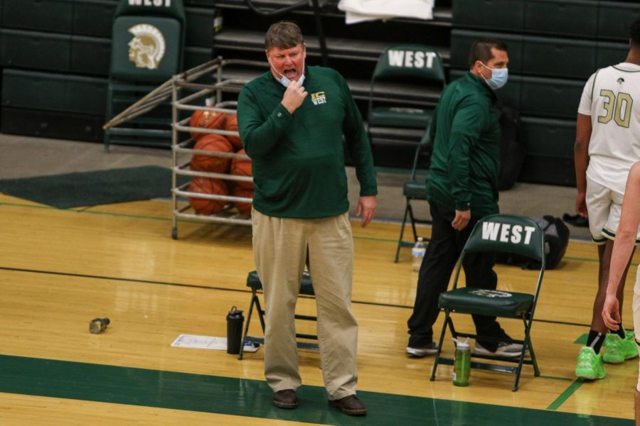 Head coach Steve Bergman calls plays from the sideline after a timeout against Kennedy on Feb. 11.