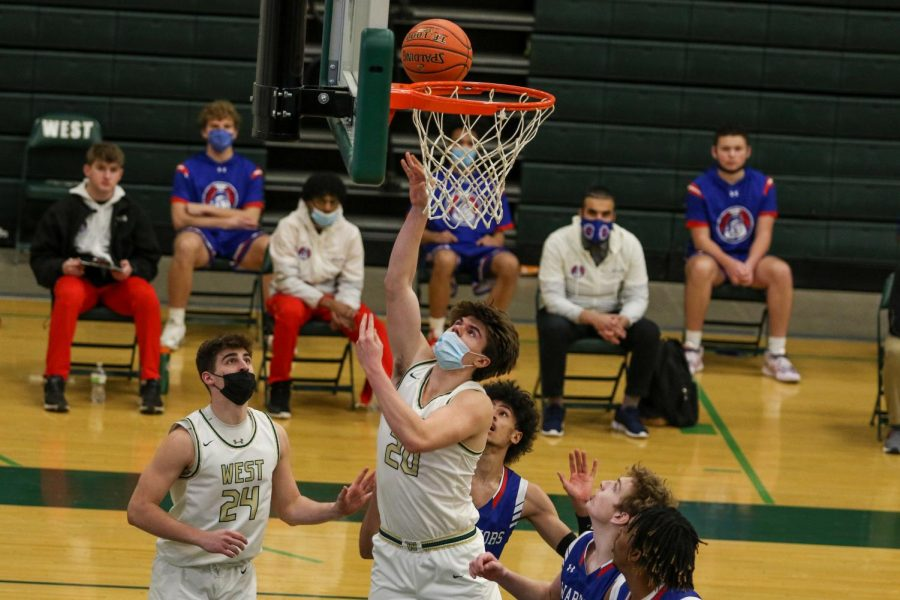 Pete Moe '22 goes up for a layup against Cedar Rapids Washington on Feb. 16.