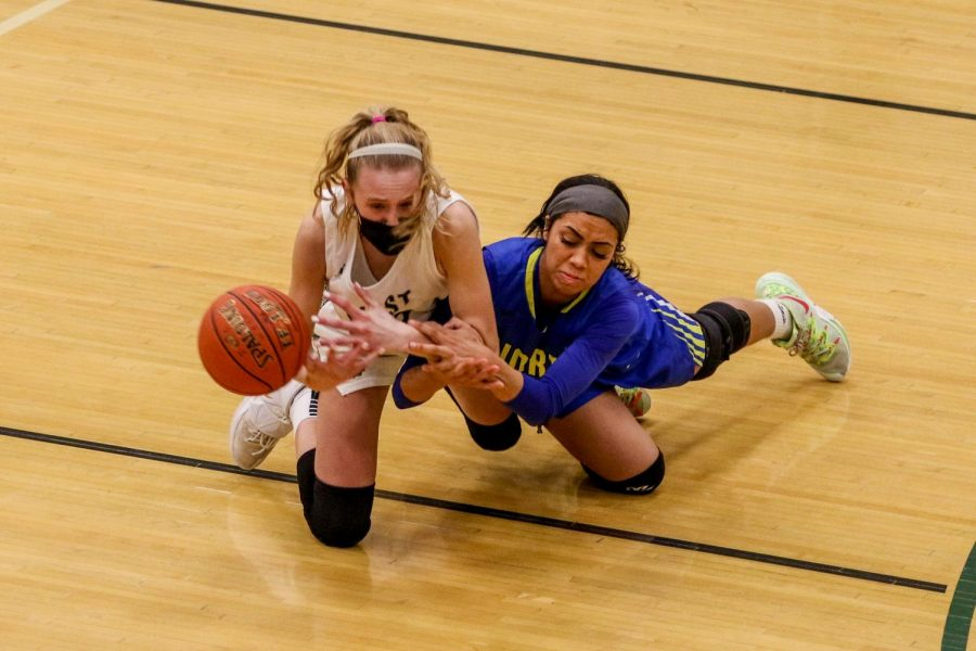Audrey Koch '21 fights for a loose ball against Davenport North during the substate final game on Feb. 23.