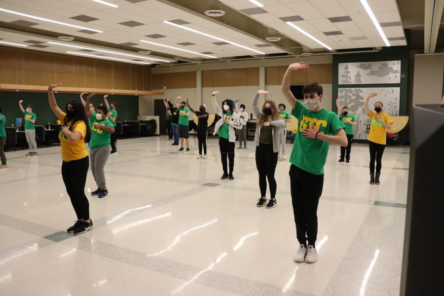 Good Time Company rehearses their performance in the West High cafeteria.