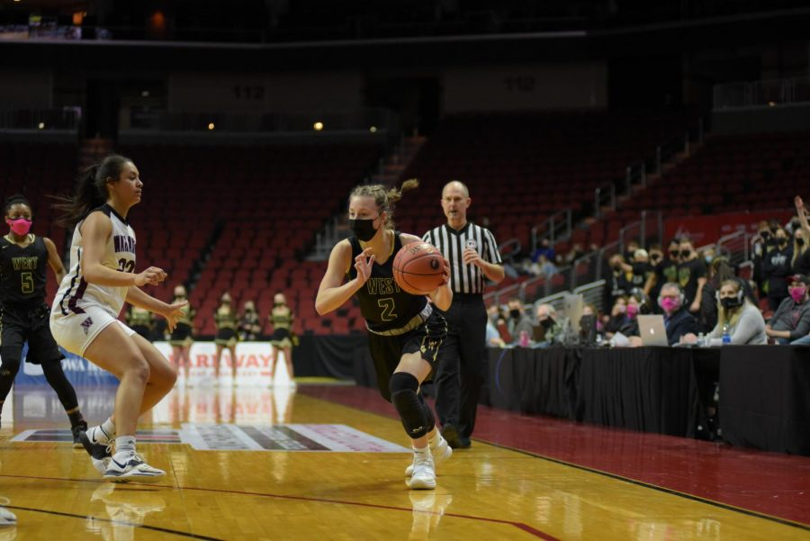 Lucy Wolf '24 drives to the basket March 1.