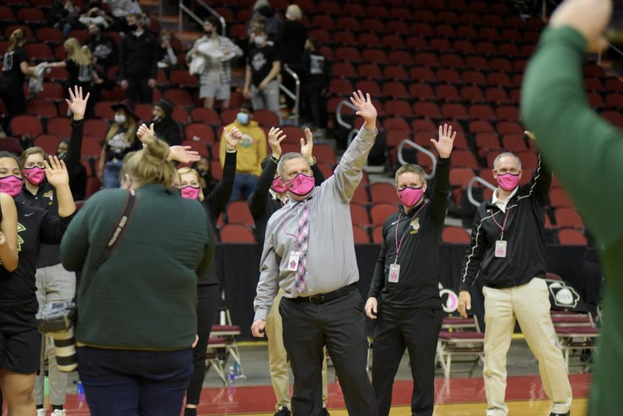 Coaches and players from Iowa City West wave to the students and parents after winning the 5A state semi-finals against Waterloo West March 1.