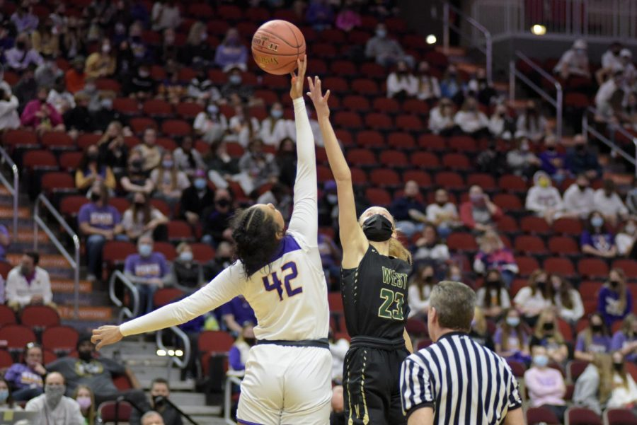 Audrey Koch '21 reaches for the ball during tip off of the 5A state semi-final, coming shy against Johnston March 4.