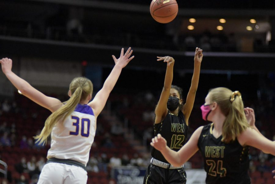 Meena Tate '23 shoots from beyond the arc against Johnston March 4.