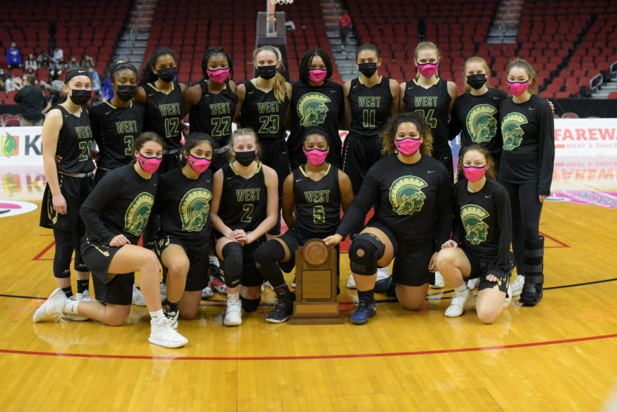 The girls basketball team poses for a picture after ending their state tournament run in the semi-finals.