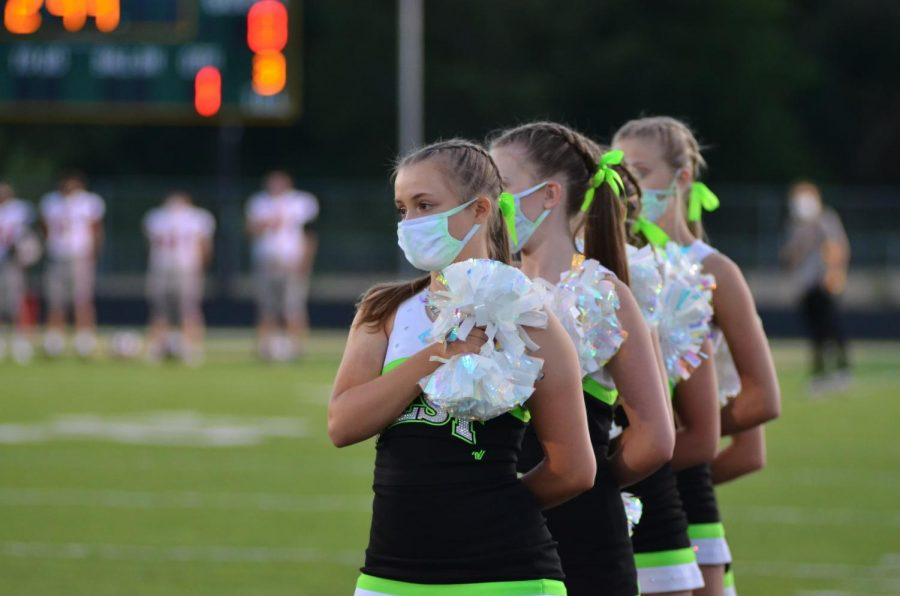 Paige Albright '23 performs a football game.