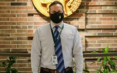 Principal Mitch Gross poses for a picture outside his office on March 23.