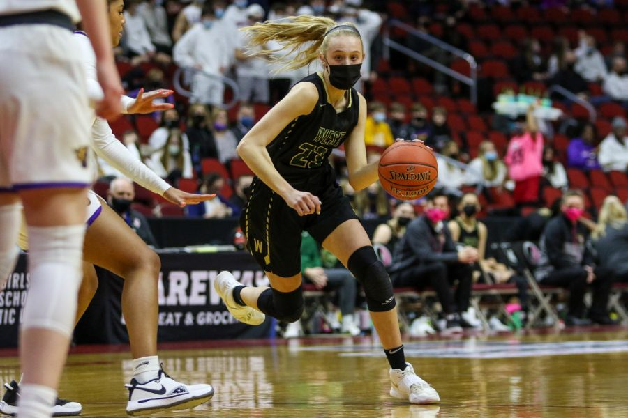 Audrey Koch '21 drives into the lane looking to score during the state semifinal game against Johnston on March 4.